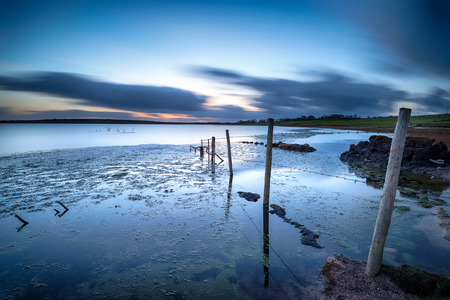 bodmin: A long exposure of night fall over a sunken fence leading in to Colliford Lake on Bodmin Moor in Cornwall