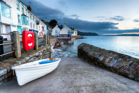 slipway: A white boat on the slipway at seaside village of Kingsand on the Rame peninsula in Cornwall