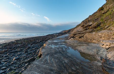 cornwall: The beach and cliffs at Portholland on the Cornwall coast