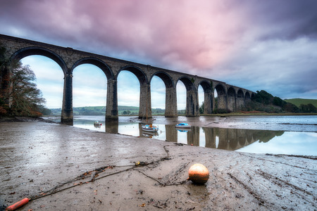 A railway viaduct crossing the quay at St Germans in Cornwall photo