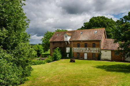 flour mill: THROOP, UK - June 2012: Abandoned flour mill on the banks of the river Stour which ceased working in 1972 Editorial