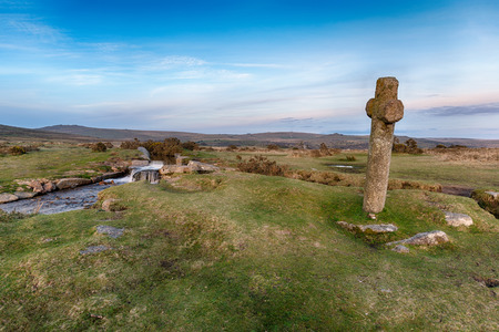 granite park: An ancient granite cross at Windy Post on Dartmoor National Park in Devon