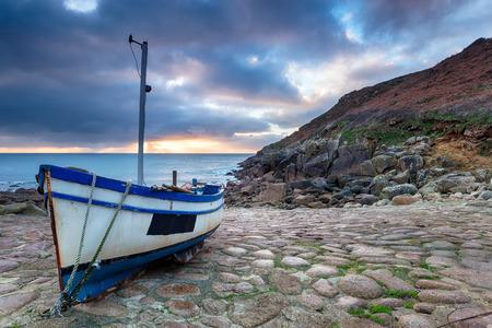 slipway: Fishing boat on the beach at Penberth Cove near Penzance in Cornwall Stock Photo