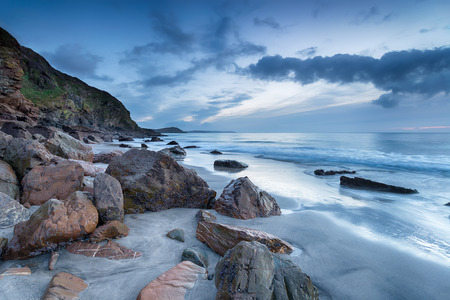 Cloudy dawn at Pentewan Sands on the Cornwall coast near Mevagissey photo