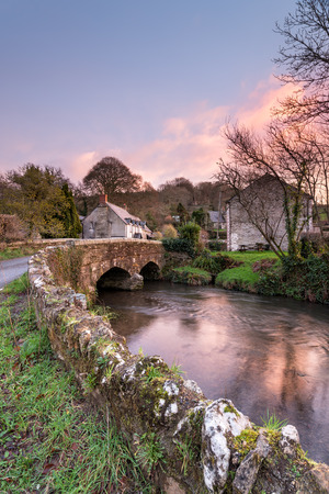 The Lerryn River as it flows under an old granite bridge at Couchs Mill near Lostwithiel in Cornwall