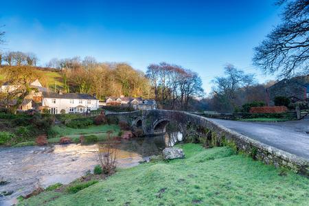 granite park: The River Walkham flowing under the old granite bridge at the picturesque village of Little Huckworthy on Dartmoor National park in Devon Stock Photo