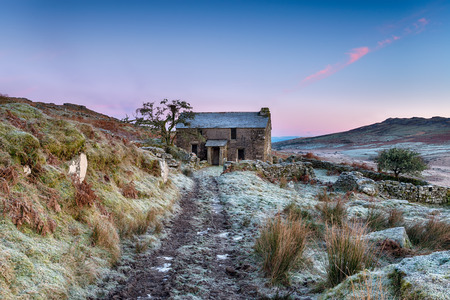 bodmin: A beautiful frosty winters morning on Bodmin Moor with an old abandoned cottage and Brown Willy, the highest point in Cornwall in the backround