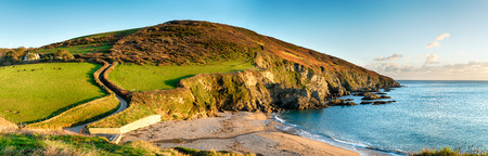 southwest: A panoramic view from the Southwest Coast Path as it passes Hemmick Beach near Gorran Haven on the south Cornwall coast Stock Photo