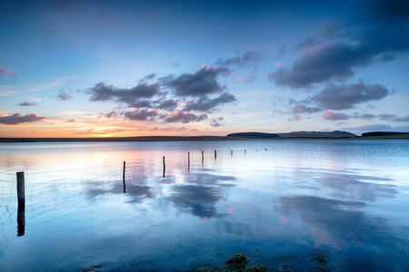 bodmin: Dramatic sunrise over the Crowdy Reservoir a large lake on Bodmin Moor in Cornwall