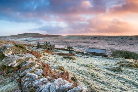 vibrant cottage: Beautiful dramatic winter sunrise over an old abandoned farm on the foothills of Brown Willy high up on Bodmin Moor in Cornwall