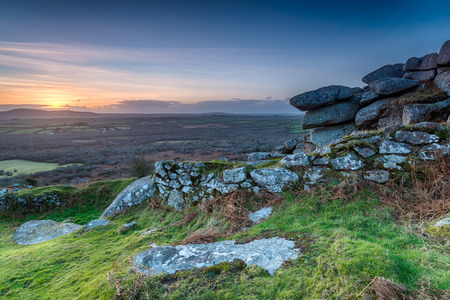 bodmin: Winter sunset over granite rock formations at Helman Tor near Bodmin in Cornwall