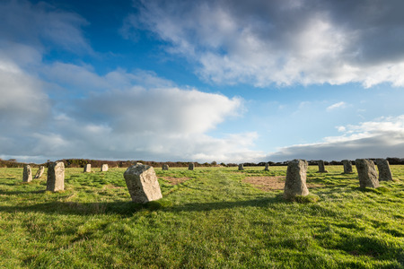 dawns: Blue sky over the Merry Maidens a neolithic stone circle near St Buryan in the far west of Cornwall - also known as the Dawns Men. Stock Photo