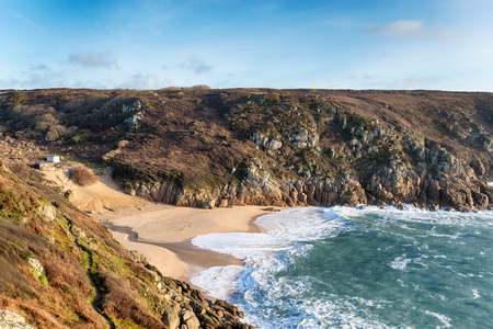 porthcurno: Looking down at the Porthcurno beach in Cornwall from cliffs on the South West Coast Path
