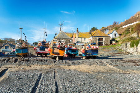 Fishing boats on the beach at Cadgwith a picturesque fishing village on the Lizard in Cornwall photo