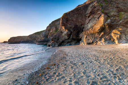 The beach and cliffs at Lizard Point in Cornwall, the most southerly tip in Britain photo