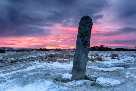 bodmin: Dramatic red sky sunrise over the  Longstone or Long Tom at Minions on Bodmin Moor in Cornwall