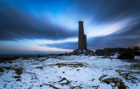 bodmin: A long exposure of a ruined chimney stack under a dramatic night sky on Bodmin Moor in Cornwall