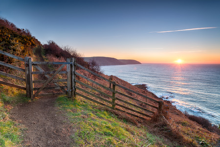 south west coast path: Beautiful sunrise on the South West Coast Path at Pencarrow Head looking out to Lantivet Bay on the south coast of Cornwall