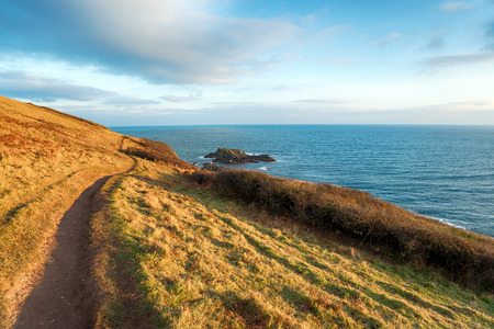 south west coast path: The South Swest Coast Path as it leaves Talland Bay in Cornwall and heading towards Looe