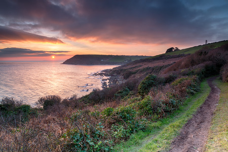 south coast: Beautiful dramatic sunset over Talland Bay on the south coast of Cornwall