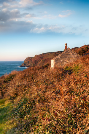 An old abandoned cottage on cliffs above Lantivet Bay on the south coast of Cornwall photo