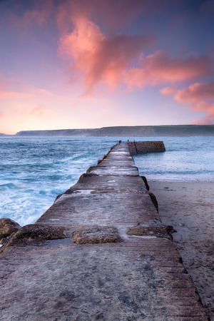 sennen: Dramatic sunset sky over the pier at Sennen Cove in the far west of Cornwall