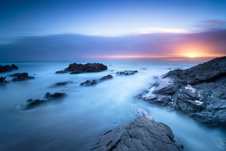 A long exposure sunset at Sharrow Point on Whitsand Bay in Cornwall Stock fotó