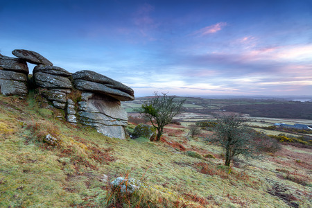 long distance: Dawn at Helman Tor a rugged area of moorland dotted with weathered granite tors near Bodmin in Cornwall, also forming part of the Saints Way long distance trail