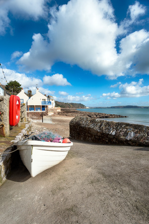 slipway: Small fishing boat laden with nets on the slipway at Kingsand on the Rame peninsula on the south east coast of Cornwall Stock Photo