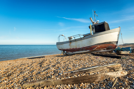 deal in: A fishing boat on a pebble beach at Deal in Kent