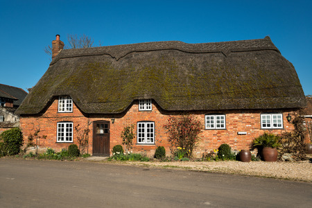 thatched cottage: Thatched cottage near Shaftesbury in Dorset Stock Photo