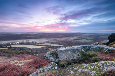 moorland: Dramatic sunrise from moorland on Helman Tor near Bodmin in Cornwall Stock Photo