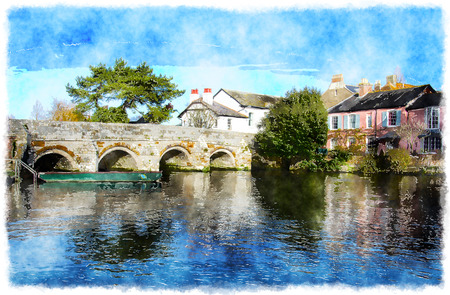 english countryside: The river Avon flows between cottages at Christchurch in Dorset Stock Photo