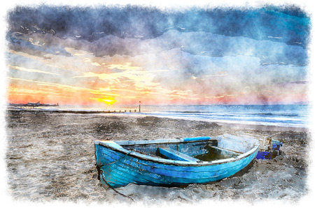 Turquoise blue fishing boat at sunrise on Bournemouth beach