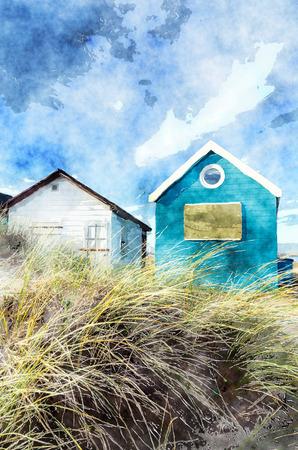 hengistbury: Beach huts and boats in sand dunes at Mudeford Spit on Hengistbury Head near Christchurch in Dorset. Stock Photo