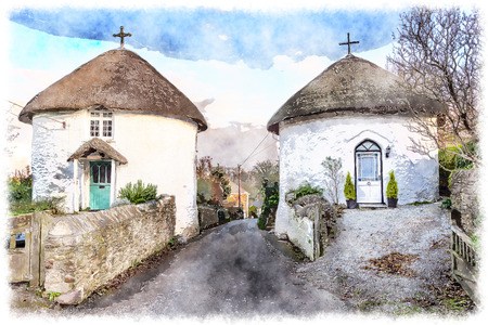 Beautiful thatched round houses at Veryan on the Roseland peninsular in Cornwall