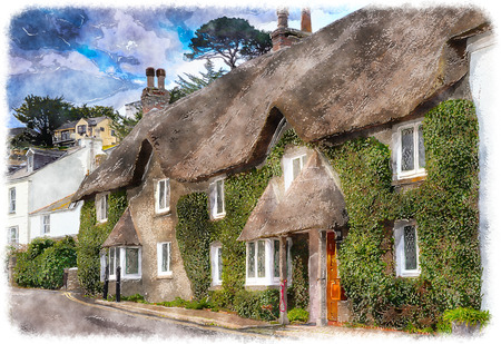 Pretty thatched cottages at the seaside town of St Mawes near Falmouth in Cornwall