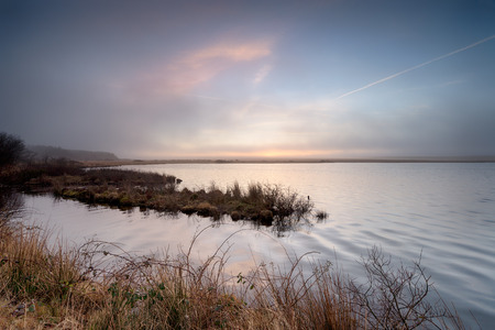 bodmin: Foggy sunrise over Crowdy reservoir on Bodmin Moor in Cornwall