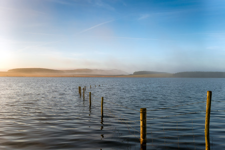 bodmin: Misty dawn at Crowdy reservoir  Bodmin Moor in Cornwall, looking out Roughtor shrowded in mist Stock Photo