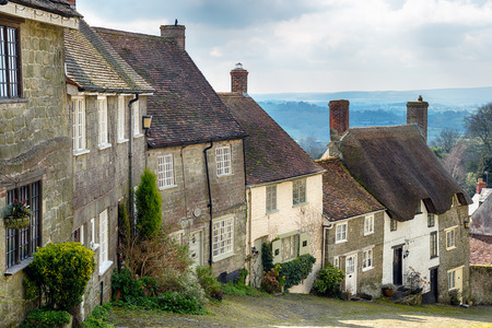 shaftesbury: A row of sleepy cottages on a cobbled street at Gold Hill in Shaftesbury, Dorset Stock Photo
