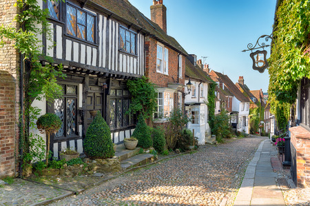 Pretty Tudor half timber houses on a cobblestone street at Rye in West Sussex