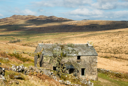 willy: An old abandoned farmhouse on Bodmin Moor in Cornwall with Brown Willy, Cornwalls highest point in the background
