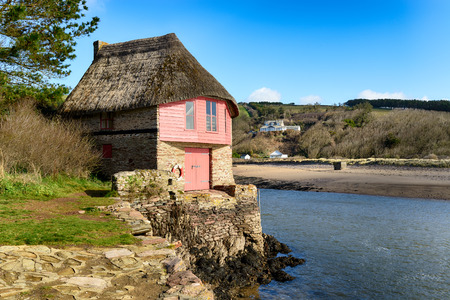 estuary: Beautiful thatched boat house at the mouth of the river Avon at Bantham on the South Hams coast in Devon Stock Photo