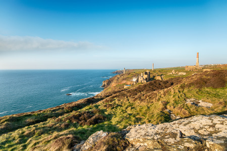 south west coast path: Cornish engine houses on the South West Coast Path at Levant near Pendeen in Cornwall Stock Photo