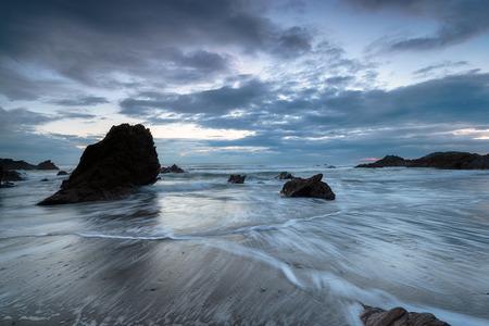 Dusk at Whitsand Bay on the south Cornwall coast photo