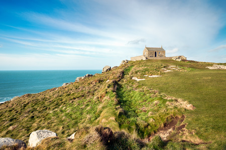 grassy knoll: The Island at St Ives in Cornwall, a grassy knoll that rises above the town and is a small peninsula, the chapel at the top is St Nicholas Chapel Stock Photo