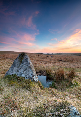 standing stone: Sunset over a standing stone at Stannon Stone Circle on Bodmin Moor in Cornwall