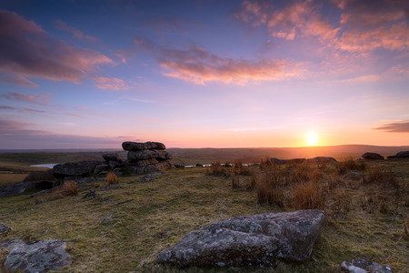 bodmin: Stunning dramatic sunset on top of Tregarrick Tor on Bodmin Moor in Cornwall