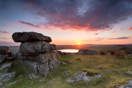 bodmin: Beautiful stunning sunset over granite rock formations at Tregarrick Tor overlooking Siblyback lake on Bodmin Moor in Cornwall