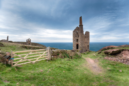 house series: The ruins of Wheal Owles and old engine house from copper mining on cliffs at Botallack on the Cornish coast, also used in TV series